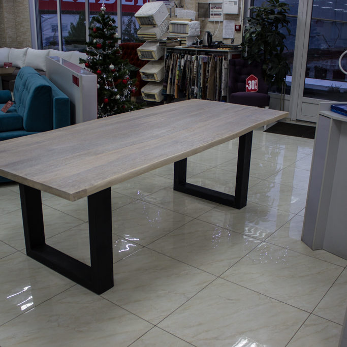Wooden table with straight metal legs