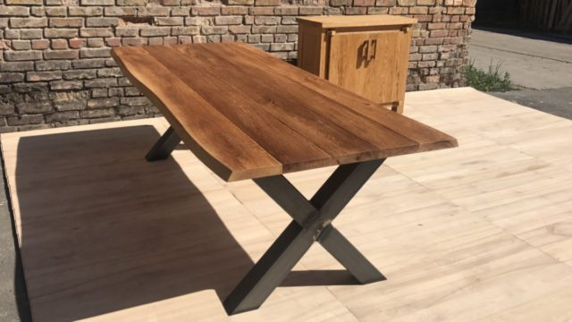 Outdoor dining table with metal legs