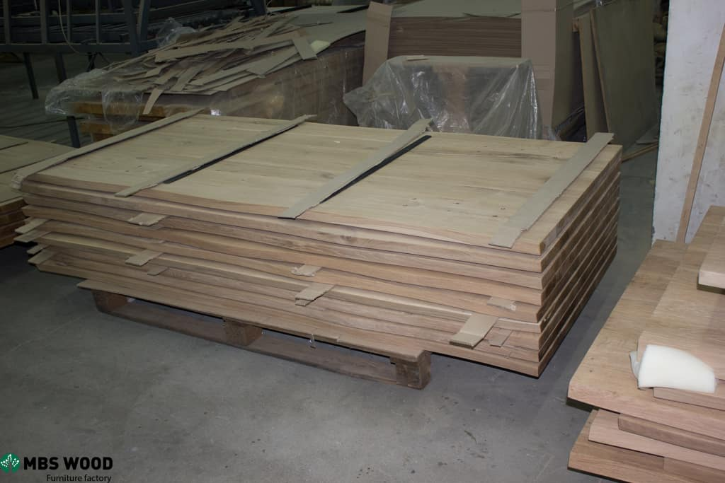Pile of wooden table-tops from oak wood
